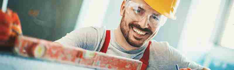 Trade Direct Insurance Smiling Tradesman At Work